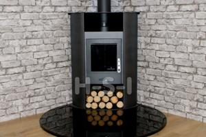 We can supply hearths, pictured is a highly polished smooth granite hearth - please call to discuss options - tear drop shape, perfect for a corner.