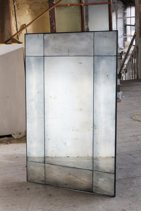 Border Panel Mirror<br/><br/>£780 per sq.m<br/><br/>Similar to our panel mirror but using a darker shade of antiqued mirror as a 'frame' for the centre lighter glass. <br/><br/>This mirror can be made with any size and number of tiles in a variety of different antiqued mirror finishes, see antiqued mirror glass under products on our website for further information. <br/><br/>Please can you also turn on the lightbox function for this mirror