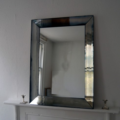 Slope Mirror £700.00   The antiqued bevelled mitered sides and plain centre give this mirror a very clean and sharp look which enhances any contemporary decorative scheme.  Price £700.00 Per sq. metre