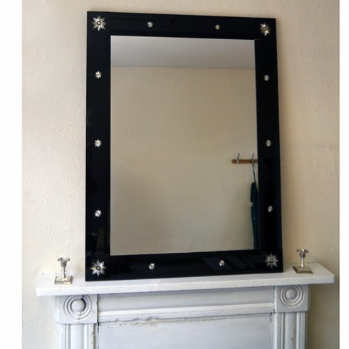 Black Star and Garter<br/><br/>£1,280.00<br/><br/>Introducing the much darker version of our Star and Garter mirror. The sides are black bevelled glass enhanced with small engraved glory stars.<br/><br/>Example size: Width 30' x Height 40'<br/><br/>Price: £1280.00 per sq. metre