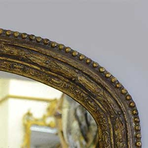 Dark Antique<br /><br />This is an example of a dark antique gold finish on our Laurel Leaf overmantel.