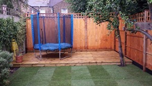 Softwood garden decking constructed at garden in Queens Park, North London.