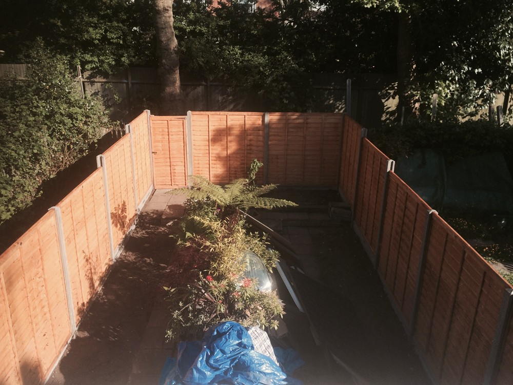 Garden Fencing North London - Lap panel fence with concrete posts and kicker boards.