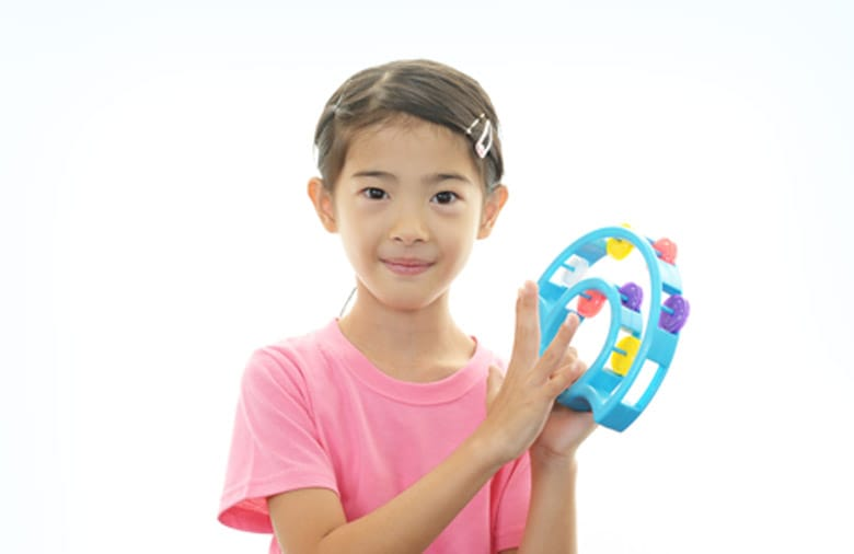 Girl Playing with Tambourine