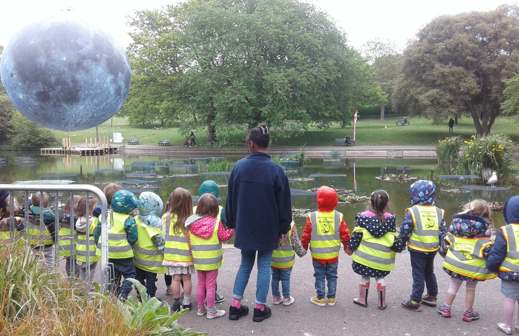 Children visiting the park with teacher