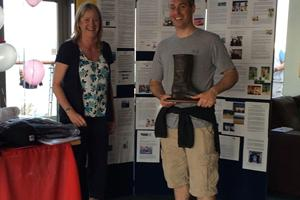 Richard Lovering with 1st Keelboat Trophy - the famous Dubarry boot - Glyn Charles Pursuit Race 2014
