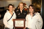 Shirley Robertson presents award certificate to Sophie Weguelin and Lucy Cripps