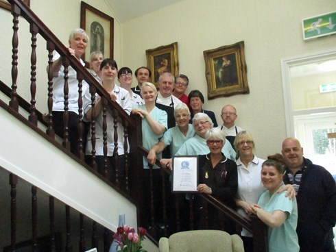 Tina Rowley Home Manager and the team of Victoria House celebrating a top 20 care home  recommendation award from carehome.co.uk