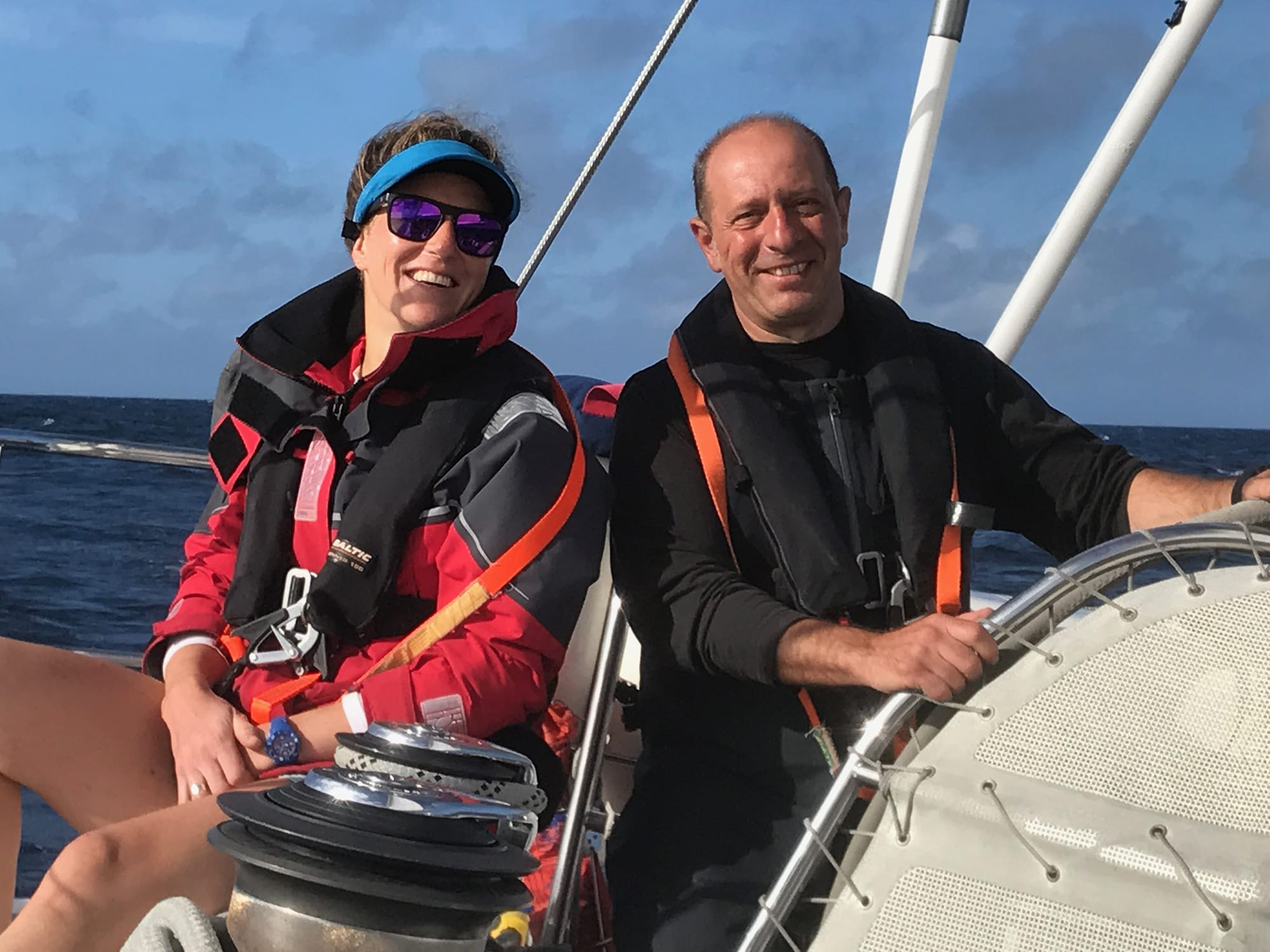 Couple at helm sailing Atlantic