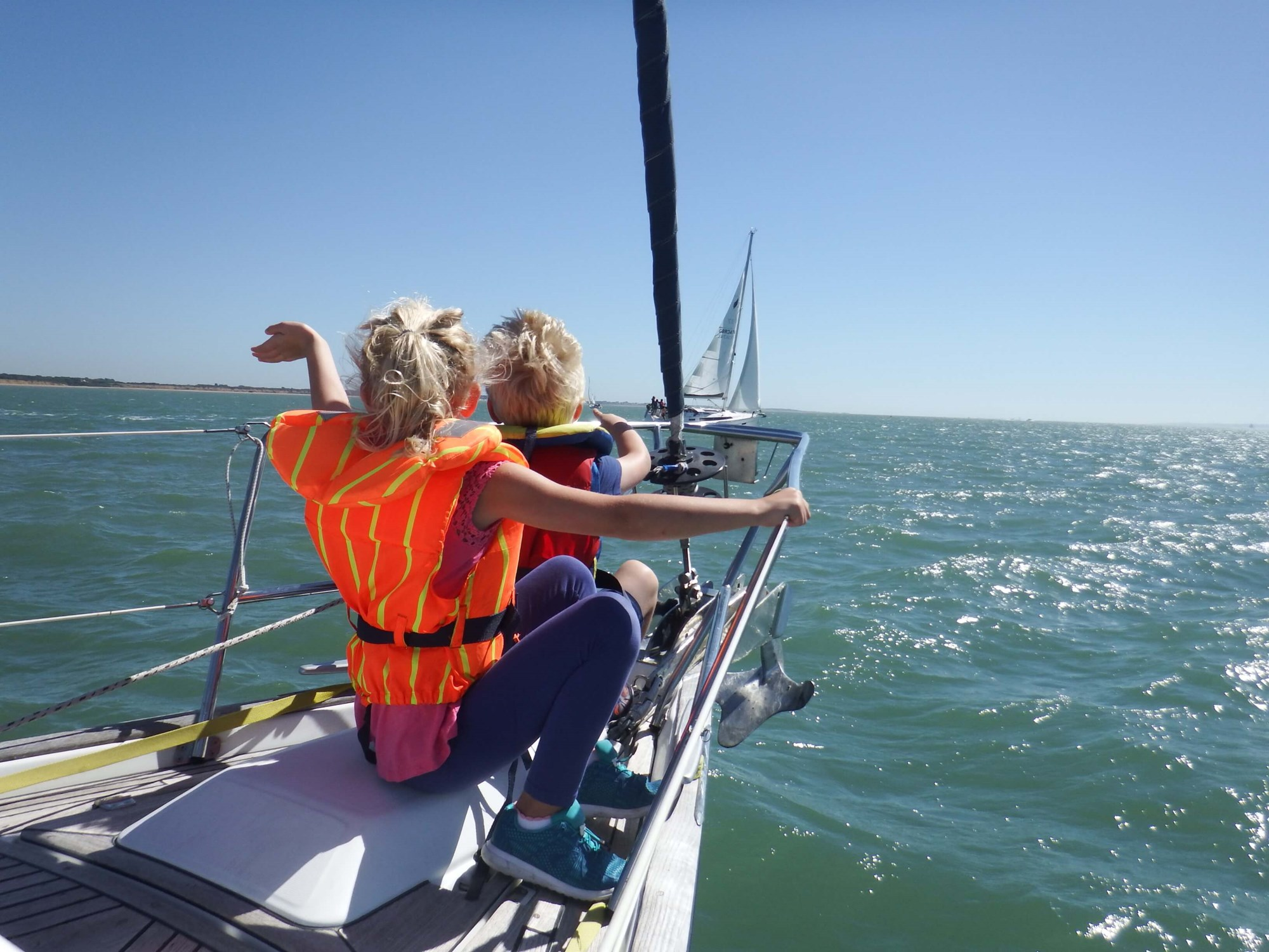 Children on bow of yacht