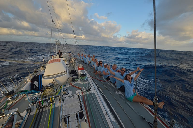 Sailing across Atlantic crew on rail