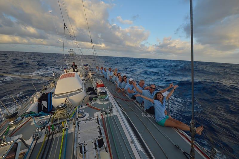 Sailing across Atlantic crew on rail