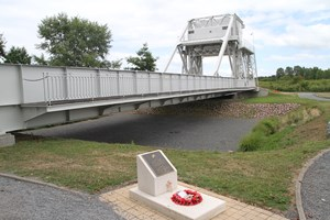 Pegasus Bridge with the memorial plaque to Lt H D Brotheridge-the first allied soldier to be killed on D Day