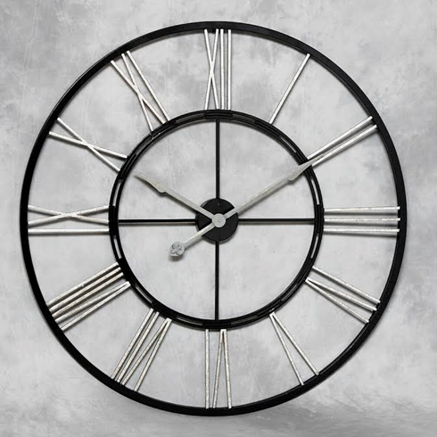 Large black and silver skeleton clock. Measures 102cm diameter