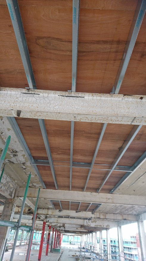 Image taken underneath the METSEC infill. showing the METSEC Roof Joists and the 18mm 'treated' Plywood.  Ready for the Roofers to apply the new roof.