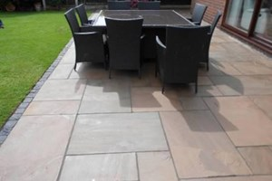 Indian sandstone patio in Ellesmere Port, colour raj green.