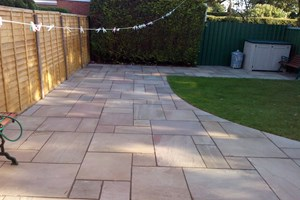 Indian sandstone patio and new lawn in Ellesmere Port. colour raj green.