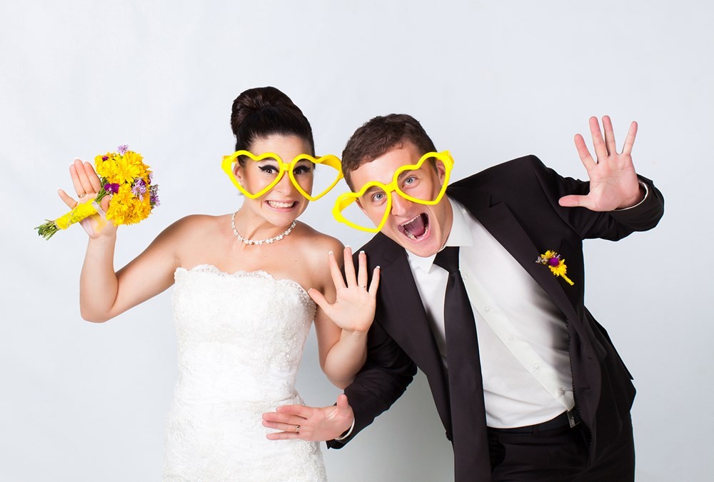 Wedding couple with glasses, photo booth hire for weddings