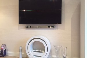 A Residential Installation Of A 65' Curved Samsung TV And Soundbar.