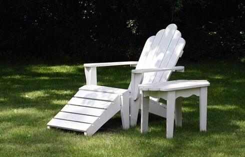 Garden lounger in sunny garden