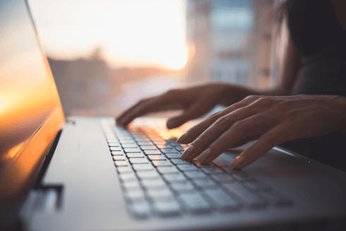 A Virtual Assistant at KL Secretarial Services undertaking transcription on a laptop