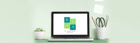 The logo of virtual assistant, Kerry Lummus displayed against a laptop.
