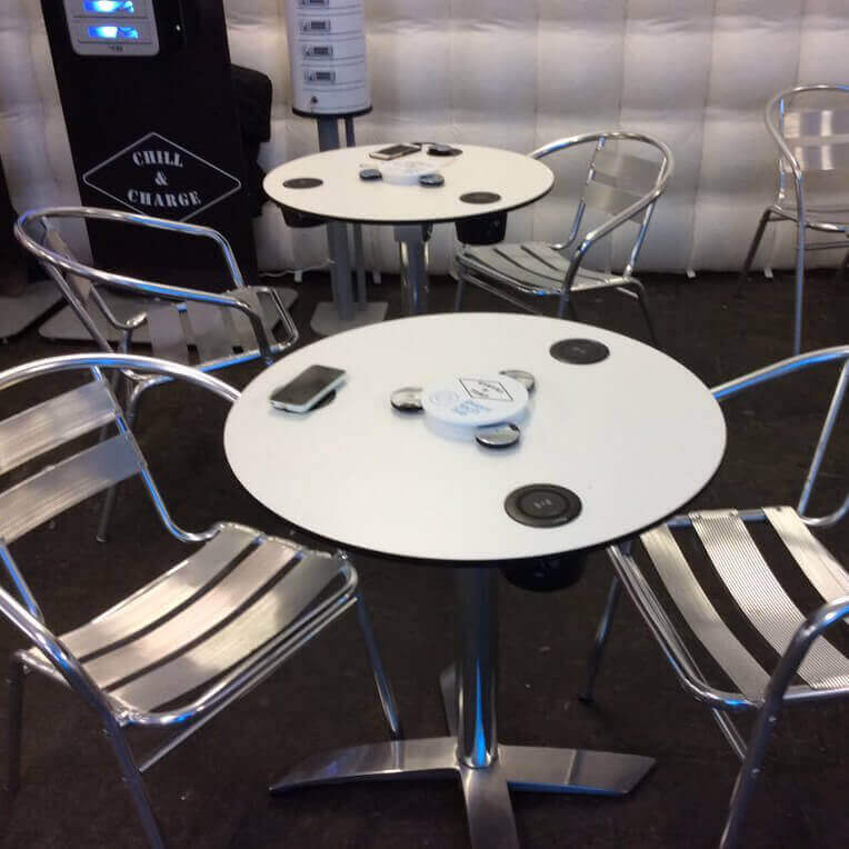 white mobile device charging table