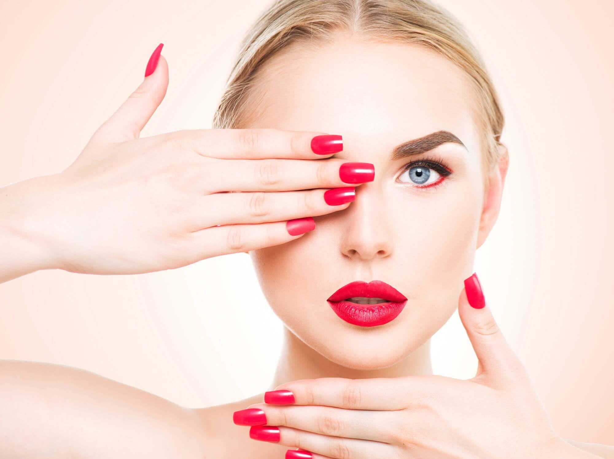 lady with matching red lipstick and nails