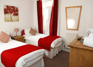 red and white twin bedroom based in southampton