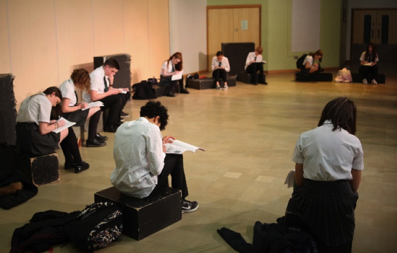teens sat down making notes and writing script