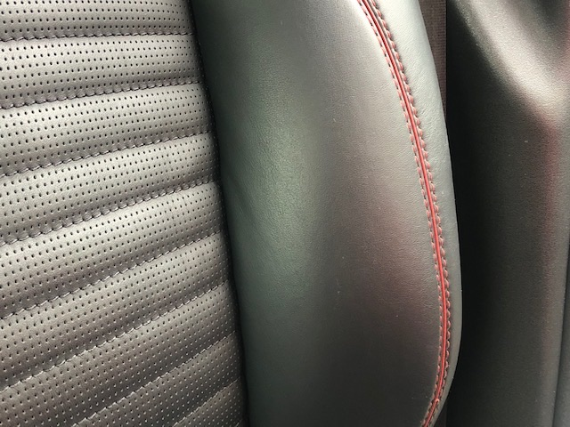Aston Martin, scratch repair to leather driver seat, after