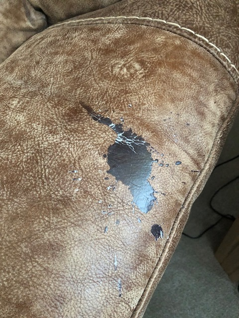 Westbridge, Aniline leather wax candle spillage removal on armchair, before