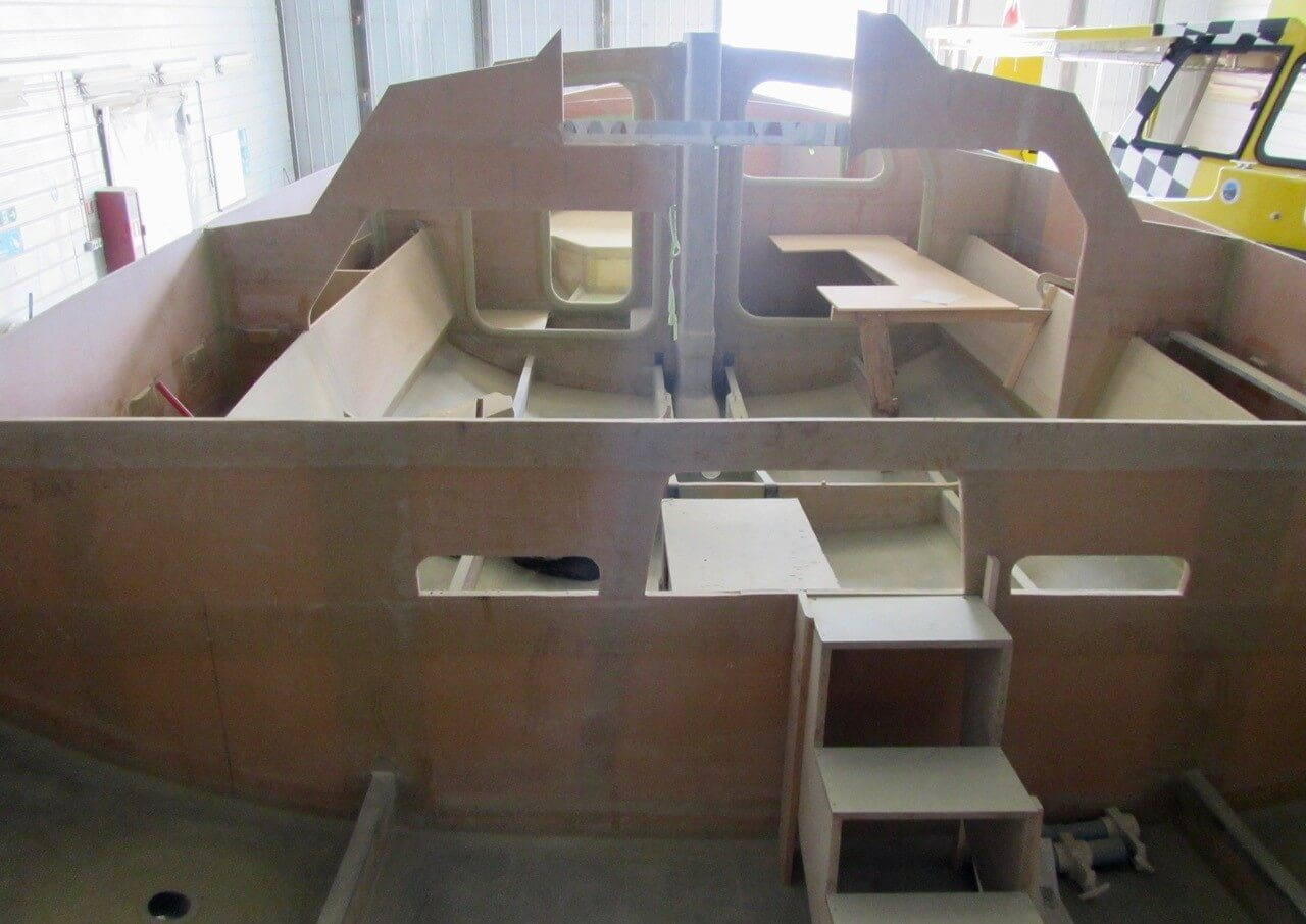 Owen Clarke cruising yacht carbon composite hull laminate structure under construction at Alwoplast yachts, Chile.