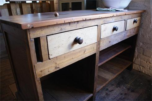 Kitchen island unit adapted from reclaimed chemist shop counter.  £1400