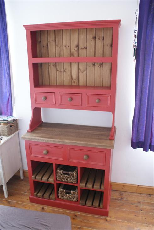 Red painted dresser with solid oak worktop and lower slats. Baskets in base.