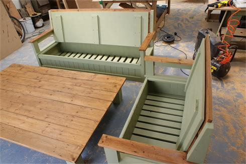 'Outdoor / indoor' settees and table, showing internal storage space. 