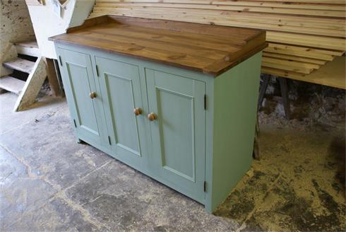 Farmhose sideboard with reclaimed pitch pine top and gallery rail.
