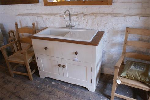 Free Standing sink unit with large ceramic sink and drainer, nickel mixer taps.