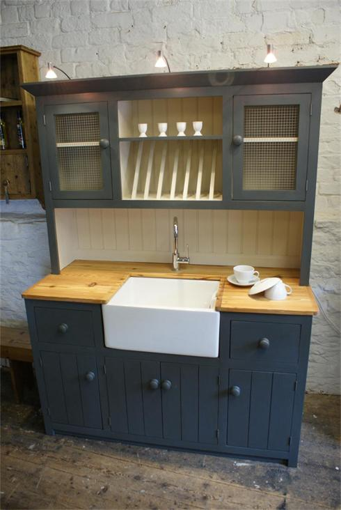 Dresser style unit featuring sink and tap installation, and halogen lights above.