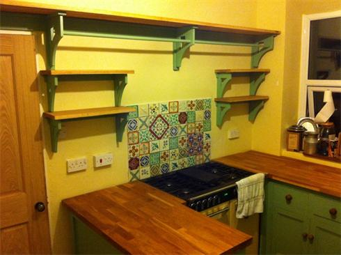 Oak shelves with painted pine bracketry to match existing kitchen installation. Approx £800.
