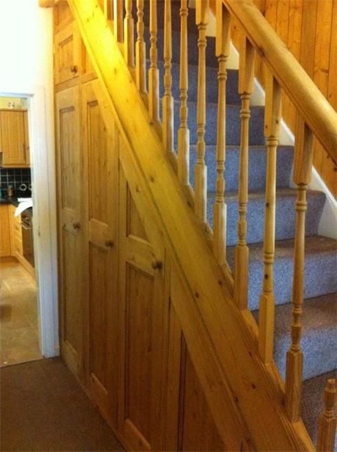 Solid pine understairs storage solution. Panelled doors and adjustable interior shelving.