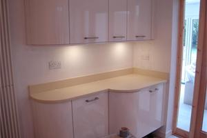 Blanco Dune Quartz on curved high gloss units showing how we can shape the Quartz to follow the shape of the units.