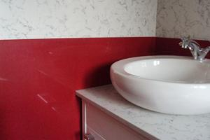 Silestone 12mm Lyra and 20mm Rojo Eros used for cladding Bathroom Walls
