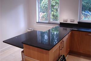Solent Kitchen Designs showing Stella Negro Quartz.