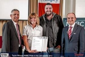 Receiving Taylor Wimpey NHBC Pride in the job awards 2013.