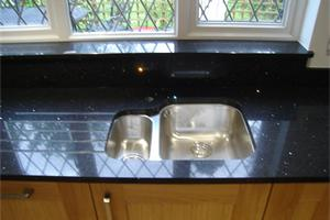 Stella Negro Quartz with undermounted Sink and Drainage Grooves.